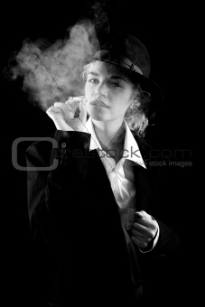 Beautiful girl in a suit, smoking