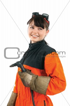 Girl welder working with burner