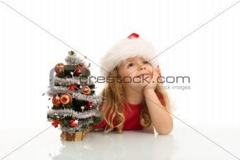 Little girl dreaming of a white christmas
