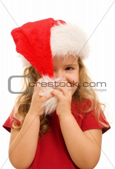 Little girl playing with christmas hat
