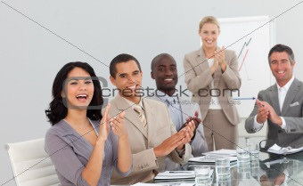 Business people at a presentation Clapping