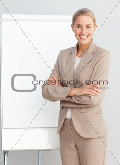 Business woman standing at a presentation board