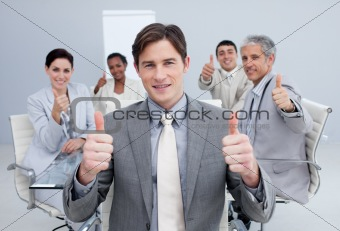 Attractive businessman celebrating a sucess with his team