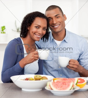 Portrait of an Afro-american couple having breakfast