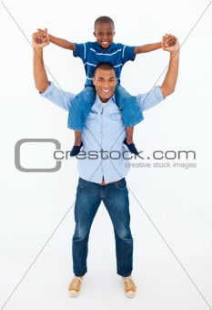 Dad giving son piggyback ride