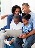 Happy young Afro-American family at home