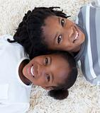 Portrait of Afro-American brother and sister on floor