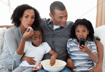 Afro-American family watching a film at home