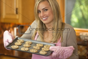 Attractive Blond Woman Baking Chocolate Chip Cookies