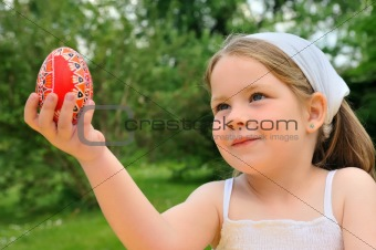 Little girl holding Easter egg