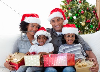 Afro-American family holding Christmas presents