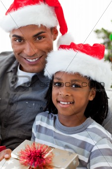 Portrait of an Afro-American father and son holding a Christmas