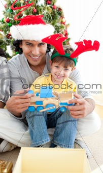 Father and son playing with a Christmas present