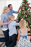 Happy Family hanging decorations on a Christmas tree