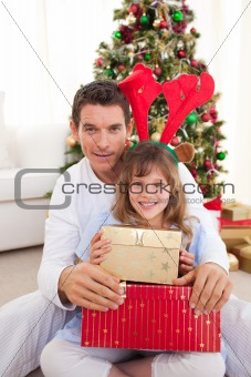 Portrait of a smiling father and child at Christmas time