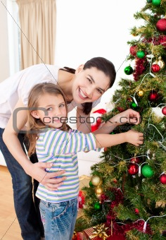 Smiling mother and child playing with Christmas gifts
