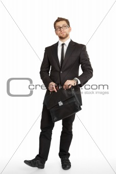 Business man in suit and glasses standing with a briefcase and t