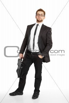 Business man in suit and glasses standing with briefcase
