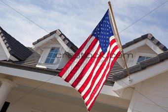 Abstract House Facade & American Flag Against a Blue Sky