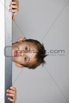 Boy looking through the doorway