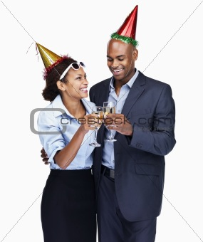 Business colleagues at a party having champagne