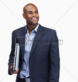 Business man in thought with a laptop on white