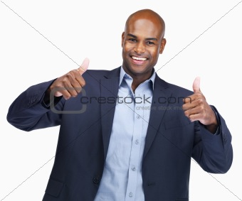Business man gesturing thumbs up sign with both hands