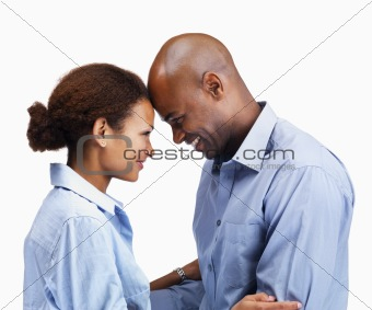Business couple head to head on a white background