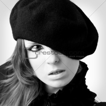 Portrait of young woman wearing beret