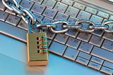 chain and digital padlock on computer keyboard
