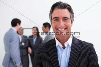 Smiling businessman leading her team