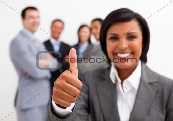 Portrait of an ethnic businesswoman with thumb up