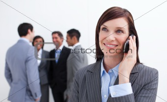 Portrait of smiling businesswoman on phone