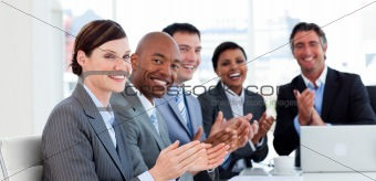 Portrait of an international business team clapping