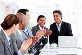 Smiling multi-ethnic business team applauding