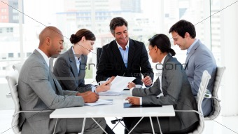 Confident manager in a meeting with his team
