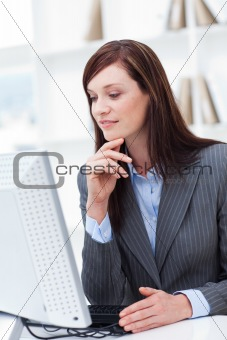 Close-up of a serious businesswoman working at a computer