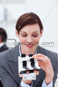 Attractive businesswoman consulting her business card holder