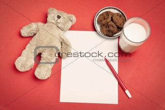 Blank letter with bear, cookies and milk
