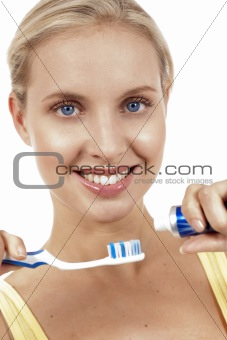 A close up of a beautiful woman with toothbrush.