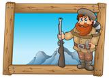 Cartoon trapper in wooden frame
