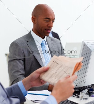 Portrait of an ethnic businessman working at a computer