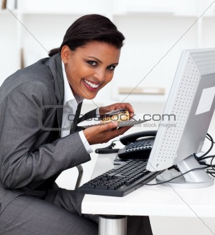 Business woman working at computer in the office.