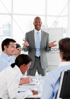 Smiling businessman doing a presentation to his colleagues