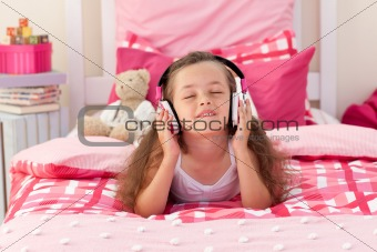 Cute girl listening music with headphones