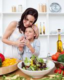 Happy mother and daughter in kitchen