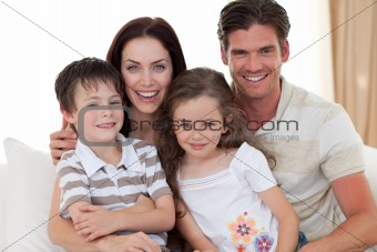 Portrait of a smiling family on the sofa