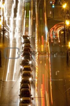 prague - high angle view of traffic on cechuv bridge at dusk