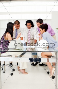 A group of architects and their manager discussing blueprints