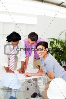 A group of architects discussing a construction plan